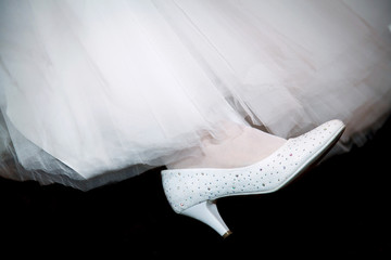 c15dfec5b Bride s feet in white stockings with lace. Dressing the bride in ...