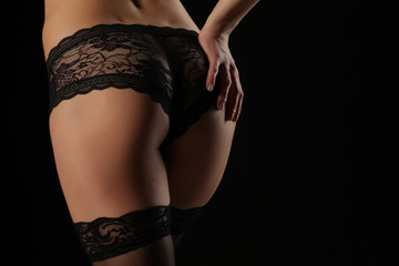 Back view of beautiful female bottom in lacy panties and nylon stockings