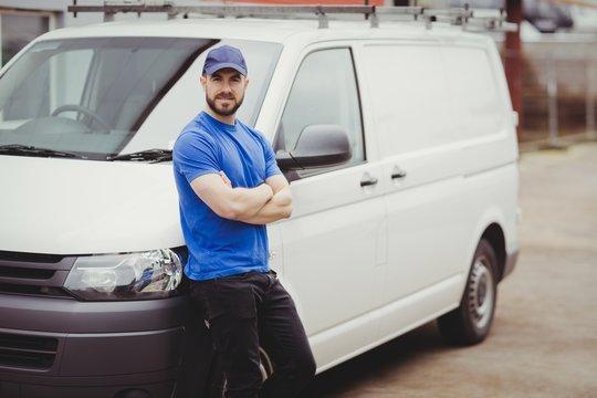 Man leaning against his van