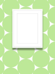 Close-up of one white blank picture frame on green circles background