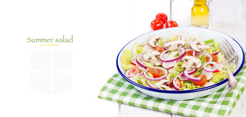Healthy fresh summer salad with letucce, radish, cherry tomatoes, red onion and champignons with italian herbs on a wooden background with olive oil, closeup, copy space.