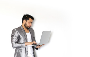 A handsome young Indian man working on laptop