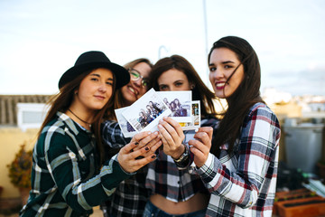 Group of Young Girls Showing Instant Photos