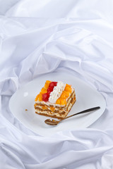 honey cake with strawberries and orange
