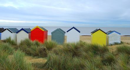 Colorful beach huts in British seaside