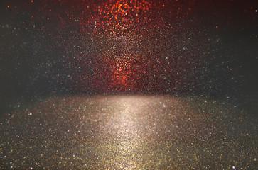 glitter vintage lights background. red, gold and black. defocused.