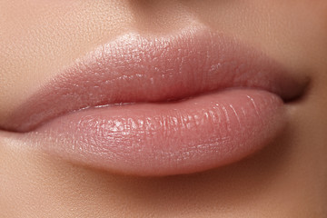 Face part. Beautiful female lips with natural makeup, clean skin. Macro shot of female lip, clean skin. Fresh kiss. Spa beauty cosmetics