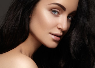 Beautiful young woman with clean skin, shiny hair, fashion makeup. Glamour make-up, perfect shape eyebrows. Portrait sexy brunette