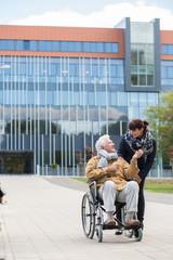 Disabled senior with carer