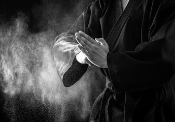 Aluminium Prints Martial arts Closeup of male karate fighter hands. Black and white.
