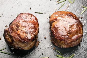 Grilled steak meat (mignon) on the dark surface