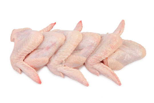 raw chicken wings on the white background