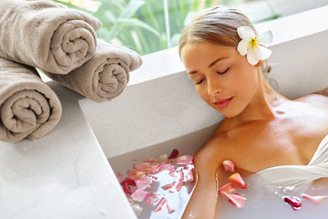 Beauty Woman Spa Body Care Treatment. Closeup Portrait Of Beautiful Smiling Model Girl Relaxing In...