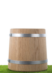 Wooden barrel on the grass with isolated background
