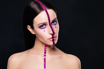 Fashion Model with Creative Makeup on Black Background