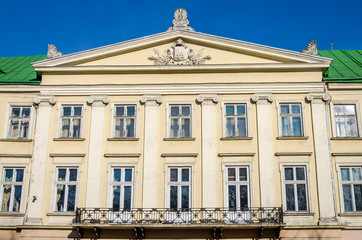 Lviv regional administration building with columns, windows and balcony on a sunny day