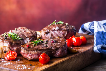Grill beef steak. Portions thick beef juicy sirloin steaks on grill teflon pan or old wooden board.