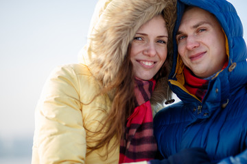 Young couple together at outdoor in winter