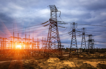 cascade of high-voltage at beautiful  landscape at sunset.