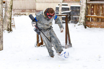 Extreme combination of paintball and football in winter
