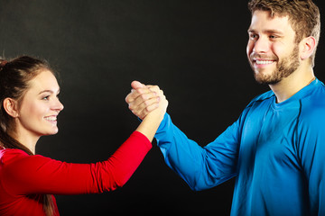 Friends man and woman clasping shaking hands.