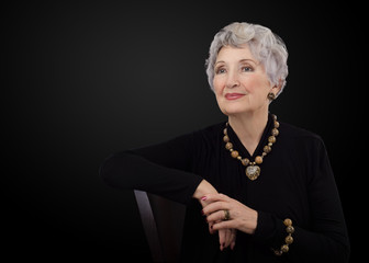 Old woman with leopard skin jasper jewelry