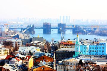 Kiev bussines and industry city landscape on river, bringe, and buildings taken in spring