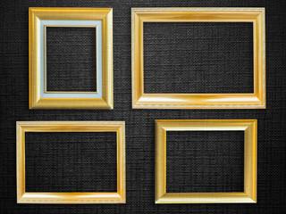 Golden picture frame over black  background