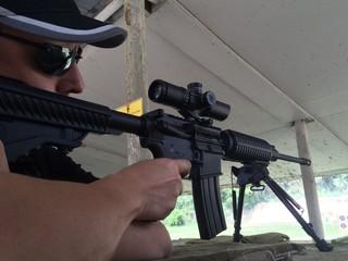 Man aims rifle at shooting range