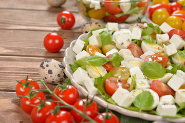 Vegetarian salad with cherry tomatoes, eggs and cheese