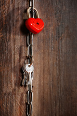 Valentine concept. Love heart hanging on chain with keys