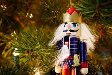 Nutcracker ornament on a Christmas tree.