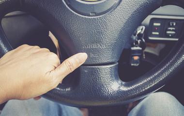 hand pressing car horn