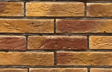 Orange and brown brick wall texture.