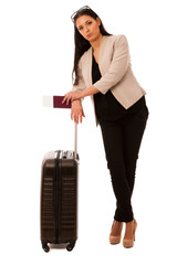 Woman with suitcase tired of waiting on airplane departure.
