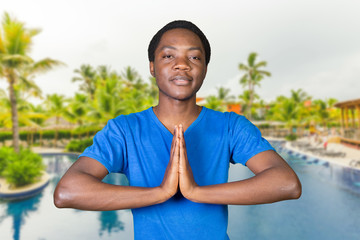 Closeup portrait of happy handsome, young man in meditation