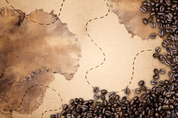coffee beans on map fabric background
