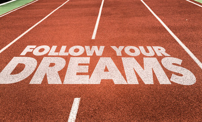 Follow Your Dreams written on running track