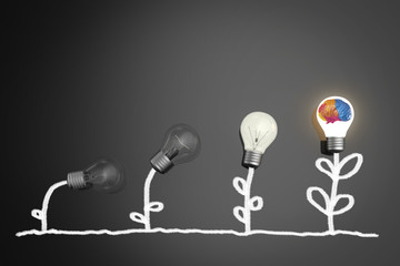 creativity concept with growing light bulb