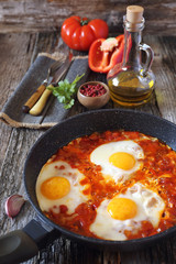 Shakshouka: fried eggs with tomatoes and peppers