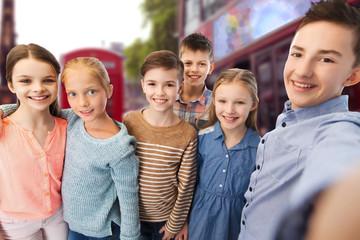 happy children talking selfie over london city