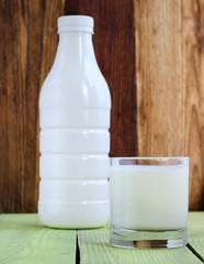 Bottle and glass of yoghurt