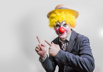 the clown shows his fingers in the top