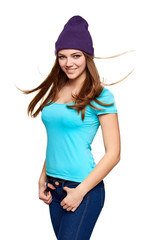 Smiling teen girl standing in hat