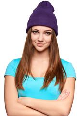 Smiling teen girl standing in hat