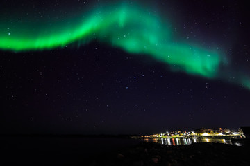 Northern lights over the old harbor of Nuuk city