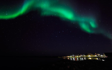 Northern lights over old harbor of Nuuk city