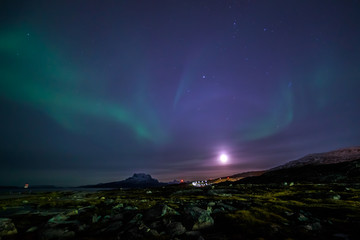 Moon shining and the northern lights, nearby Nuuk, Greenland