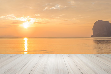 Empty top view of wooden table and view of sunset or sunrise on