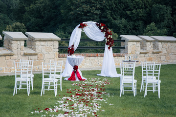 Beautiful elegant wedding aisle archway at resort